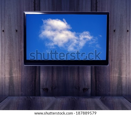 wooden background with tv and sky