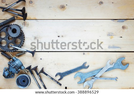 Wooden background with various automobile spare parts - stock photo