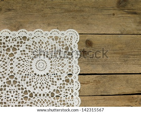 wooden background with white lace napkin