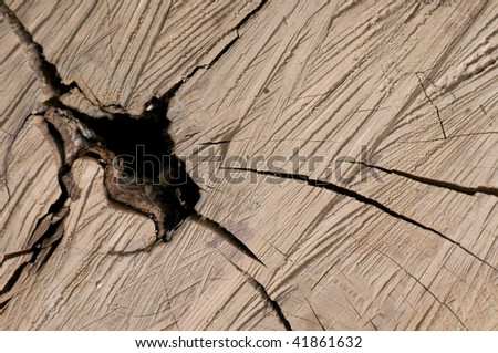 Wooden backgrounds with hole of knots - stock photo