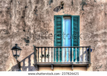 wooden balcony in a rustic wall. Processed for hdr tone mapping effect. - stock photo