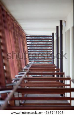 Wooden balcony with symmetric fences. Luxury - stock photo