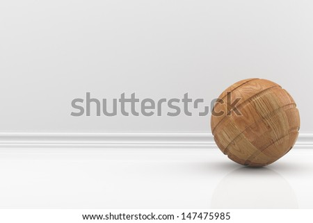 wooden ball in a white room - stock photo