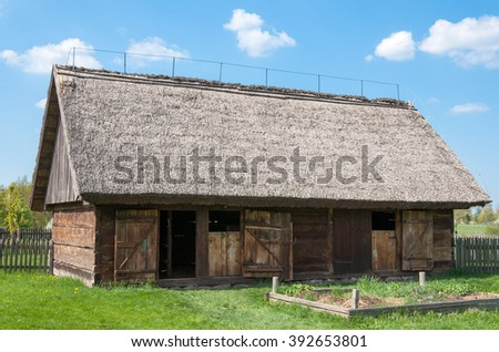 wooden barn in village - stock photo