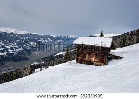 Wooden barn looking out over the valley of the Zillertal from Karspitz Mountain, Zillertal, Austria - stock photo