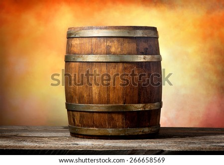 Wooden barrel on a yellow-red background - stock photo