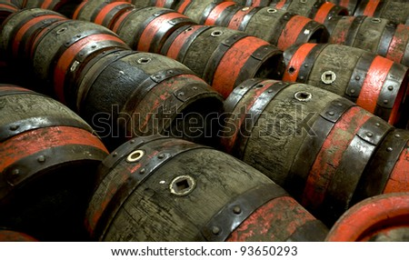 Wooden barrels at beer factory - stock photo