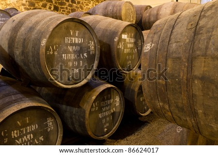 wooden barrels hold Port fortified wine to mature in wine cellars in Villa Nova de Gaia, Portugal