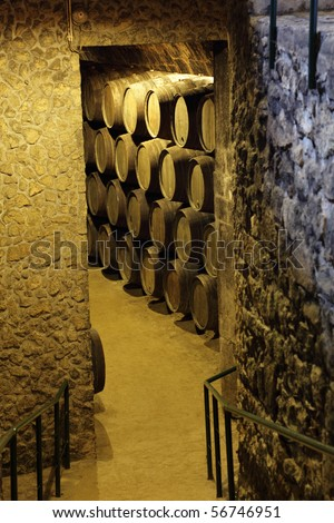 Wooden barrels in an old wine cellar - stock photo