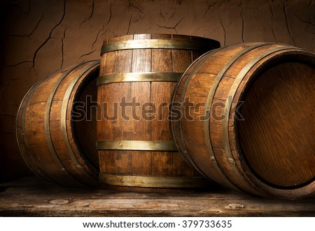 Wooden barrels in cellar - stock photo
