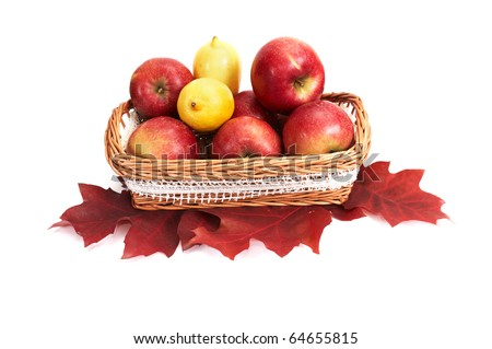 Wooden  basket full of autumn apples and lemons isolated on a white background.
