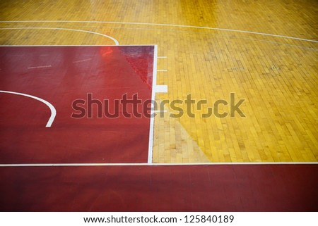 Wooden basketball court, indoor sports playground - stock photo