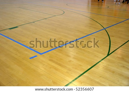 Wooden basketball court. Indoor sports playground - stock photo