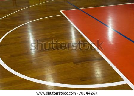 Wooden basketball court. Indoor sports playground - stock photo