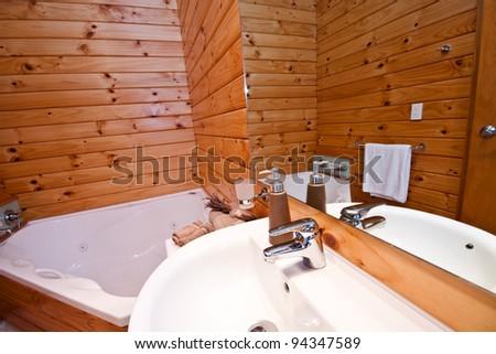 Wooden bathroom interior in mountain lodge. Fox Glacier Lodge, Fox Glacier, West Coast, South Island, New Zealand. - stock photo