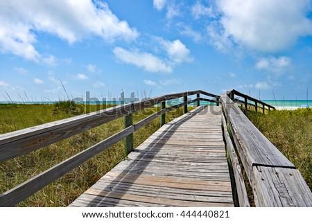 Wooden Beach Boardwalk leading to the white sandy Gulf Coast Beach - stock photo