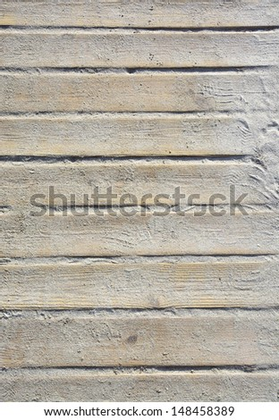 Wooden beach boardwalk with sand for background or texture. - stock photo