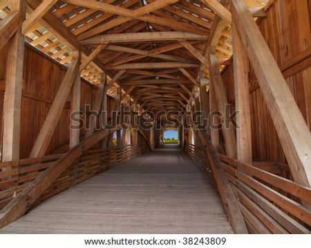 Wooden beams inside of a covered bridge in Indiana, USA. - stock photo