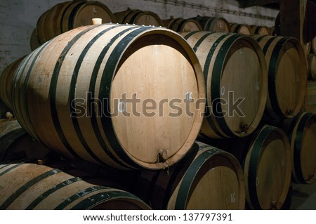 Wooden beer barrels with iron rings in the cellar, brussels, belgium