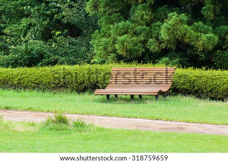 Wooden bench and pond are beautiful garden  - stock photo