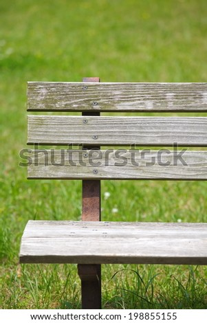Wooden bench at pubic park in summer season  - stock photo