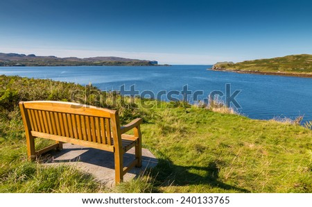 Wooden bench at the shore of Loch Harport, Isle of Skye, Scotland - stock photo