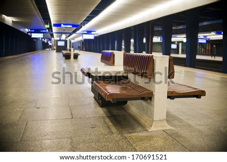 wooden bench at the train station - stock photo