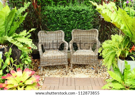 wooden bench in a garden - stock photo