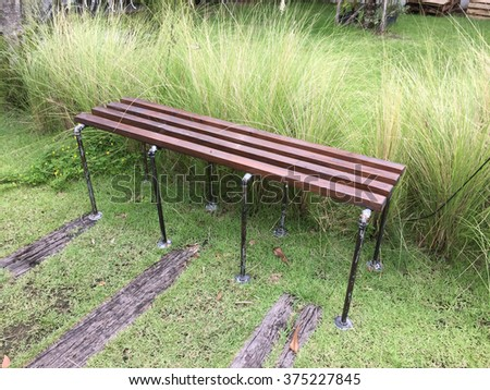 Wooden bench in a small park