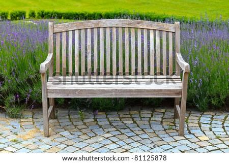 Wooden Bench in beautiful lavender garden - stock photo
