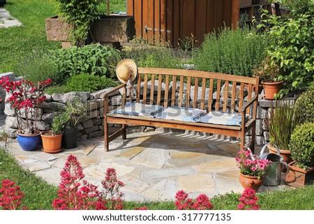 Wooden bench in the garden - stock photo