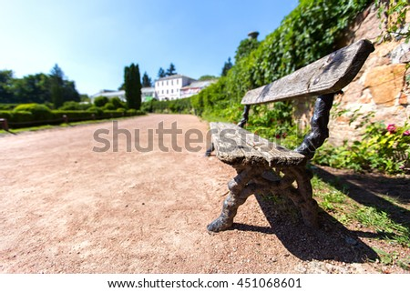 wooden bench in the park. - stock photo