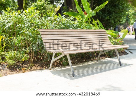 Wooden bench in the park. Bench in the park for leisure travelers. - stock photo