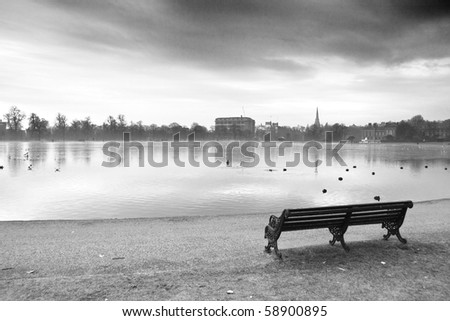 Wooden bench in the park, black and white scene - stock photo