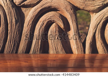 Wooden bench in the summer park. Closeup - stock photo