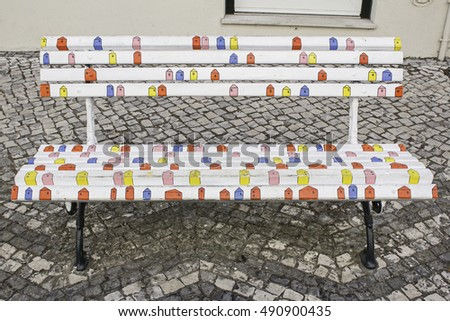 Wooden bench in urban street colors, decoration