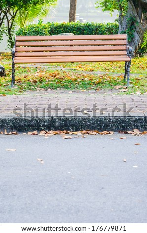 wooden bench near the lake - stock photo