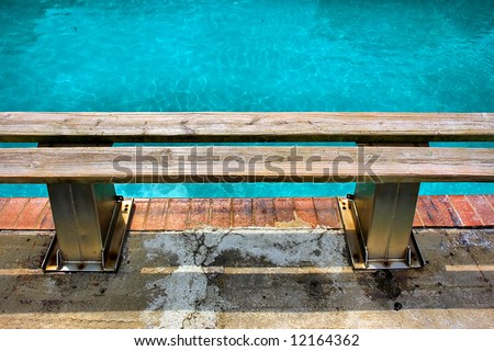 Wooden bench next to pool - closeup. Shot in Sodwana Bay, KwaZulu-Natal province, Southern Mozambique area, South Africa. - stock photo