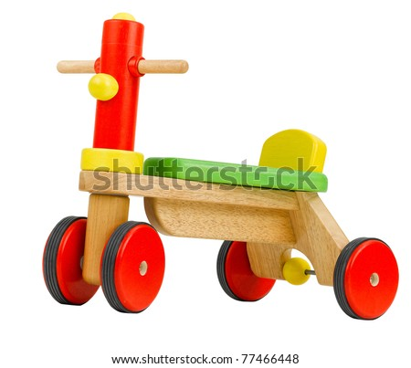 Wooden bicycle toy for kids to learn to drives isolated on white - stock photo