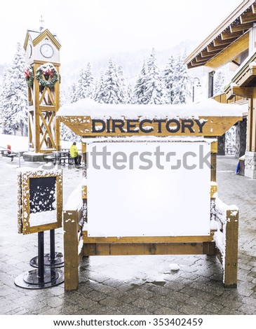 wooden billboard  with snow covered with the snow for product display montage. - stock photo