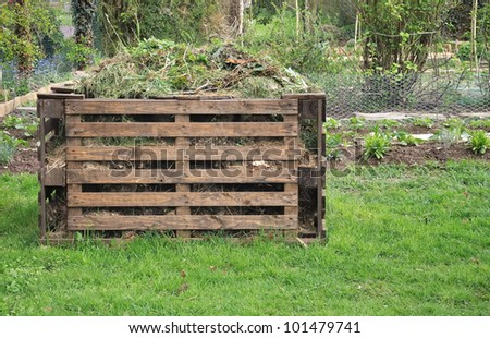 wooden bin  for organic waste in a garden - stock photo