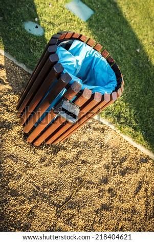 Wooden bin in green park - stock photo