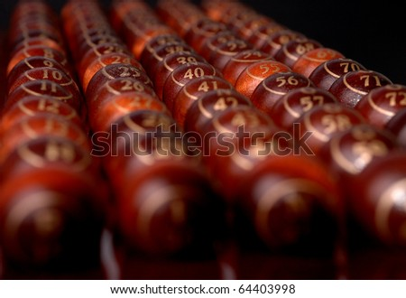 wooden bingo balls in a row.Shallow dof - stock photo