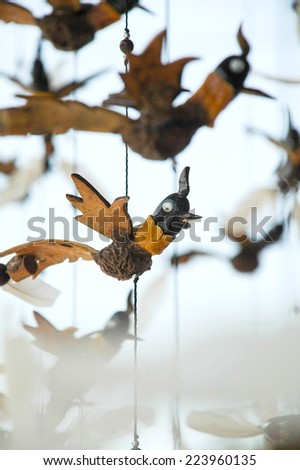 Wooden Bird in mobile - stock photo