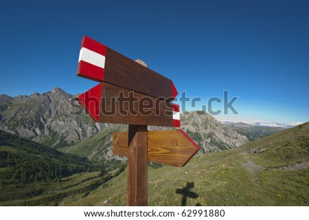 wooden blank sign post - stock photo