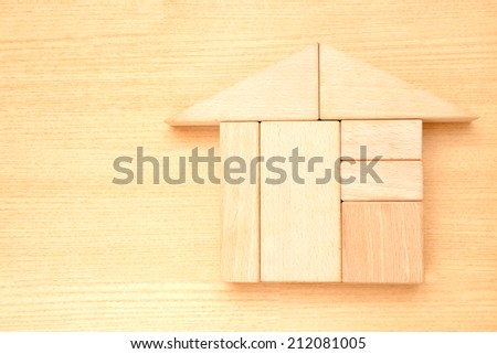 Wooden block house - stock photo