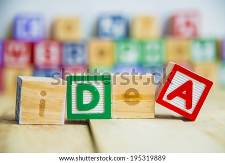 Wooden block Idea word on wooden floor - stock photo