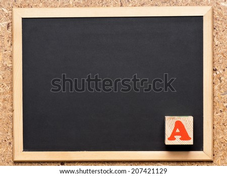 Wooden block with letter A on chalkboard, getting great grades  - stock photo