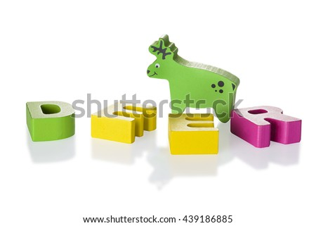 Wooden blocks arranged in the word deer and Wooden deer - isolated on white background with clipping path - stock photo