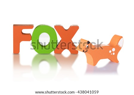 Wooden blocks arranged in the word  fox and Wooden fox - isolated on white background with clipping path - stock photo